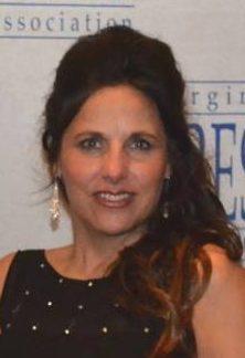 Mitzi Lusk : Advertising Director