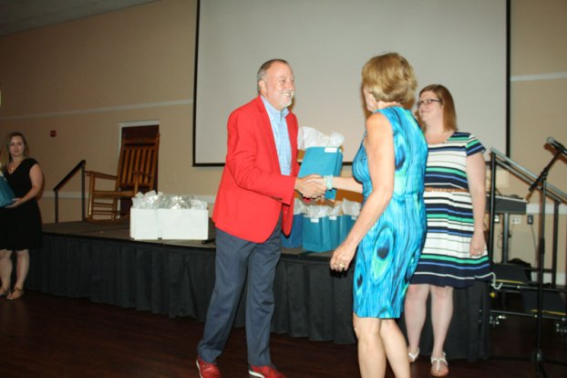 dr jim thornton congratulates carrsville elementary teacher deborah story
